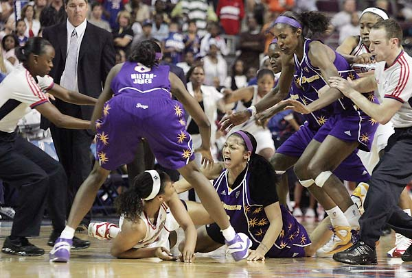 The WNBA suspended 11, including assistant coach Rick Mahorn and star rookie Candace Parker, after the first brawl in WNBA history broke out at the Palace at Auburn Hills.