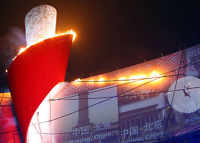 Renowned Chinese gymnast Li Ning igniting the cauldron at the opening ceremony in a majestic display, after taking a stunt-like, cable-aided journey around the top of the Bird's Nest.