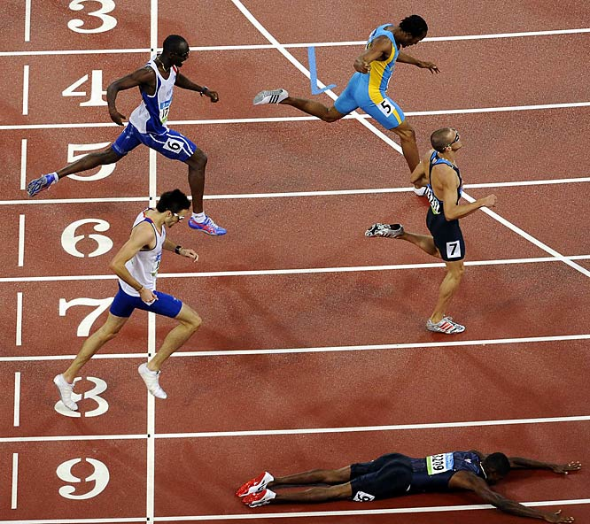 American David Neville (bottom) diving across the finish line to give the U.S. a sweep in the 400-meter run. Lashawn Merritt (not pictured) won gold and Jeremy Wariner (Lane 7) the silver.
