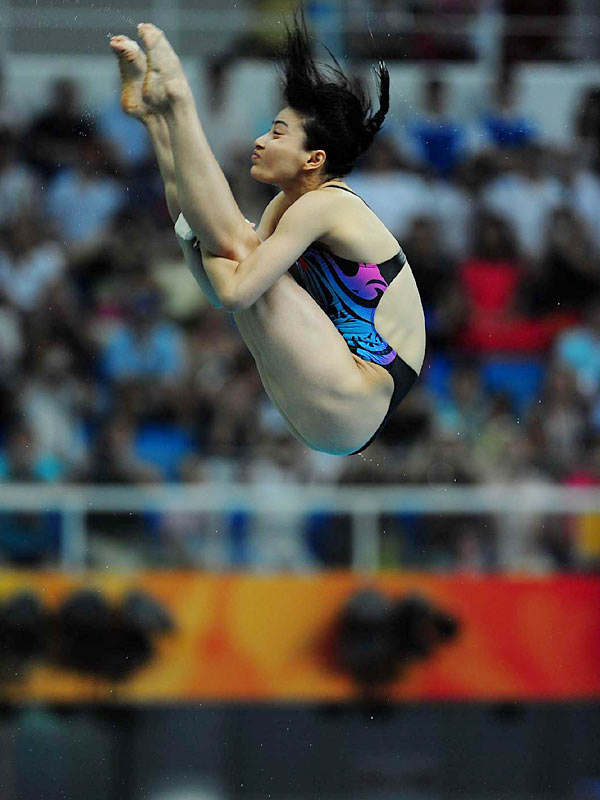 Chinese diver Guo Jingjing adding two more gold medals to her collection, becoming the most decorated female diver in Olympic history.