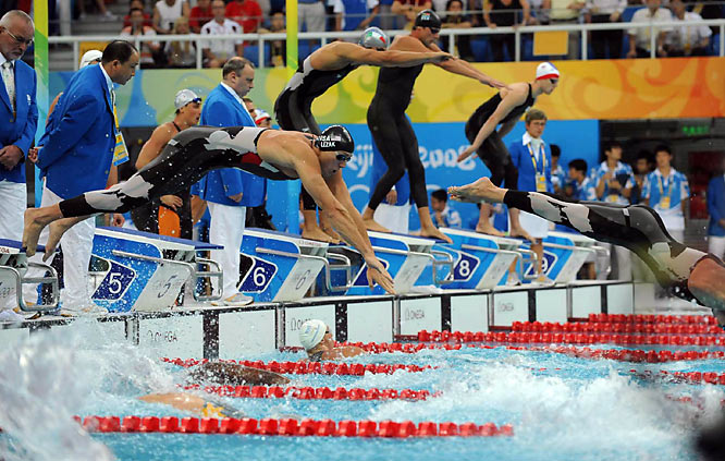 Jason Lezak (left) of the U.S. swimming the fastest anchor leg in the history of the 4x100-meter, enabling the U.S. to set a world record time of 3:08.24 and helping preserve Michael Phelps' march toward eight gold medals.