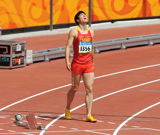 Liu Xiang walking off the track, unable to run in the 110-meter hurdles because of a nagging injury. His pullout sank the spirits of the 1.3 billion Chinese natives whose hopes he had carried.