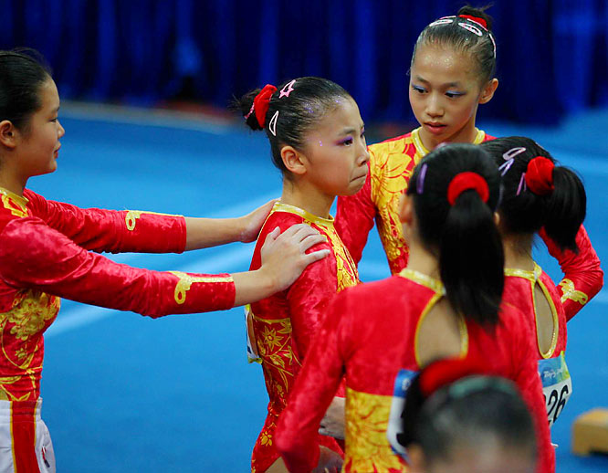 Chinese gymnasts coming under scrutiny for their ages as three were believed to be 14.
