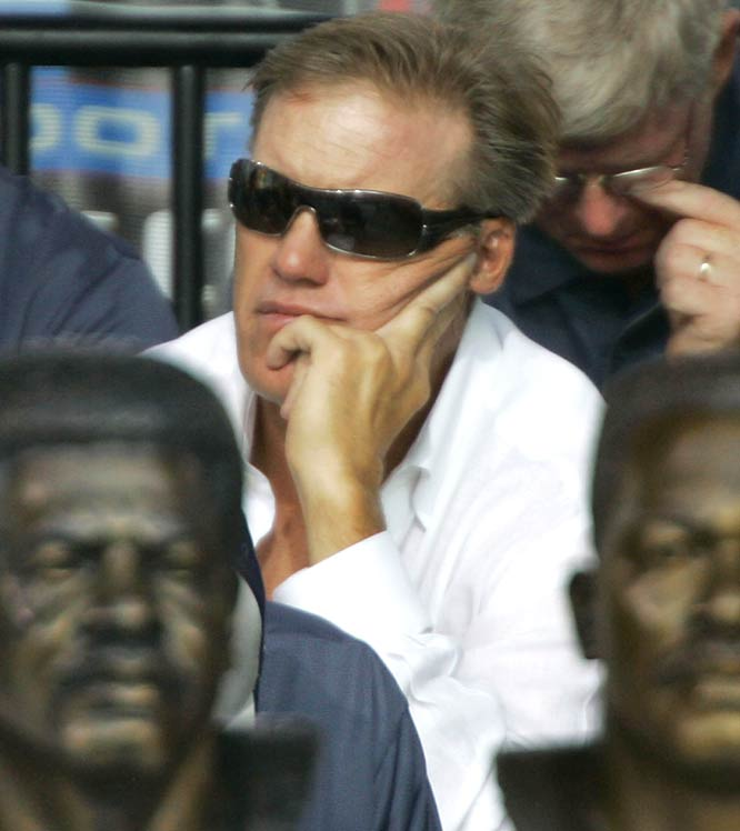 Hall of Famer John Elway (Class of '04) watches intently as longtime Broncos teammate Gary Zimmerman gets his Hall call. Elway won two Super Bowls and threw for 51,475 yards in 16 NFL seasons.