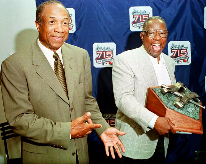 Hank Aaron (right), the holder of the career home run record (755) and RBI record (2,297); Frank Robinson (left), the first player to win the MVP in both leagues and the first black manager in the majors; Travis Jackson, an outstanding offensive and defensive shortstop for the Giants during 1920's, and former commissioner Happy Chandler, who provided leadership in breaking baseball's color line are inducted in the Hall of Fame.