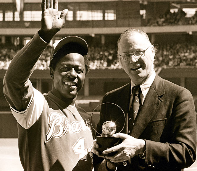 Temporary MLB Commissioner Bowie Kuhn (pictured here in 1974 with Hank Aaron) is elected to a seven-year term by the team owners.