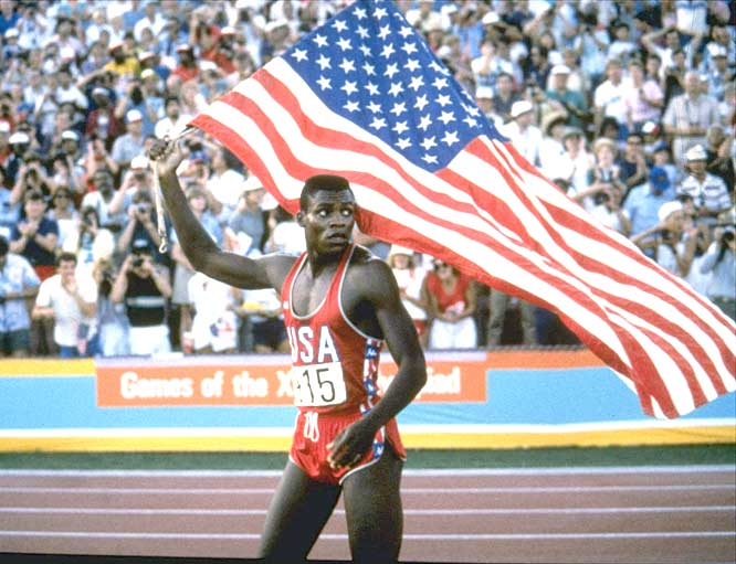 Carl Lewis wins a gold medal in the 100-meter dash at the Los Angeles Summer Olympics.