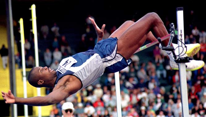 Charles Austin sets a new U.S. high jump record of seven-feet, 10-inches.