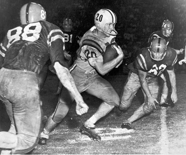 LSU football legend Billy Cannon is sentenced to five years in prison for counterfeiting. He was released after three years.