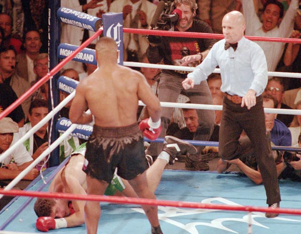 In his first match since serving a three-year prison sentence for rape, Mike Tyson returns to the ring and knocks down Peter McNeeley twice in 89 seconds and is declared the winner after McNeely's manager throws in the towel.