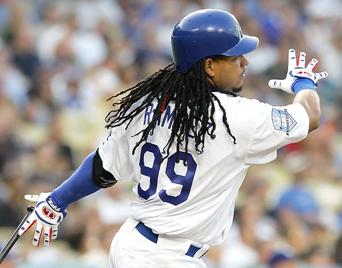 Manny Ramirez smacks his first home run -- and 511th of his career -- in the first inning of Saturday's game.