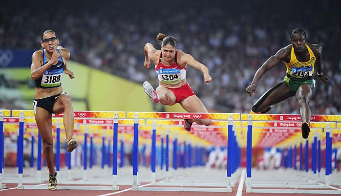 Lolo Jones of the U.S. (left), Priscilla Lopes-Schliep of Canada and Delloreen Ennis-London of Jamaica during the 100-meter hurdles semifinals.