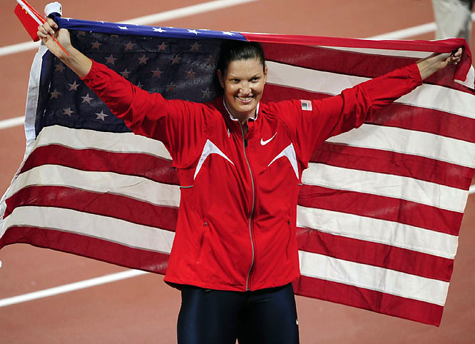 Stephanie Brown Trafton of the United States wins the gold medal in the discus with a mark of 64.74 meters (212 feet, 5 inches). The 28-year-old was third at the U.S. trials but had the best throw by an American this season.
