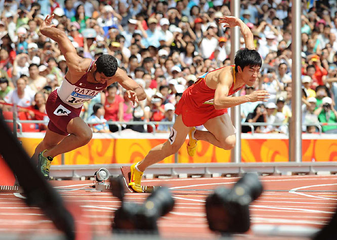 "Liu ran only a couple hurdles before hunching over in pain Monday. As Liu limped back to the blocks, the crowd started chanting ""Liu Xiang, jia you!"" (Liu Xiang, add fuel!). His next try was a false start, and his final efforts at another gold medal were dashed."