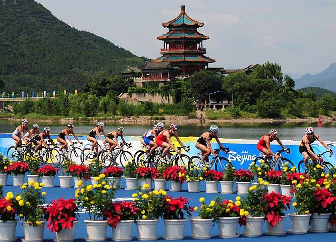 Competitors take part in the cycling portion of the women's triathlon final.