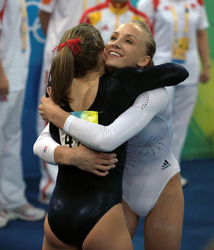 Shawn Johnson and Nastia Liukin share a hug at the women's beam final.