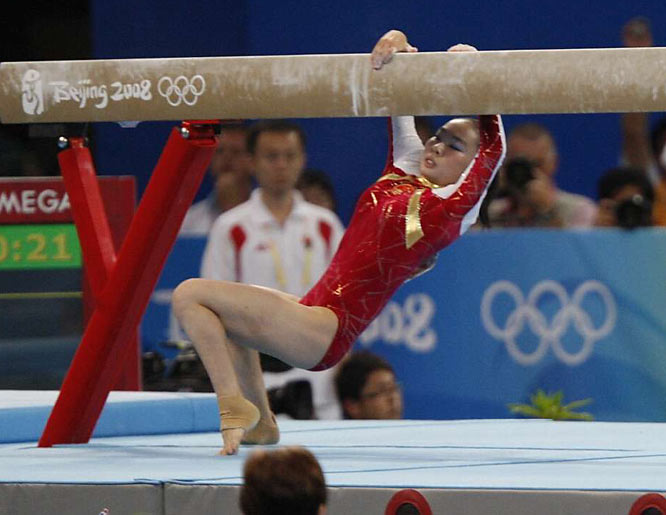 Li Shanshan of China falls off the beam during her routine at the women's beam final.