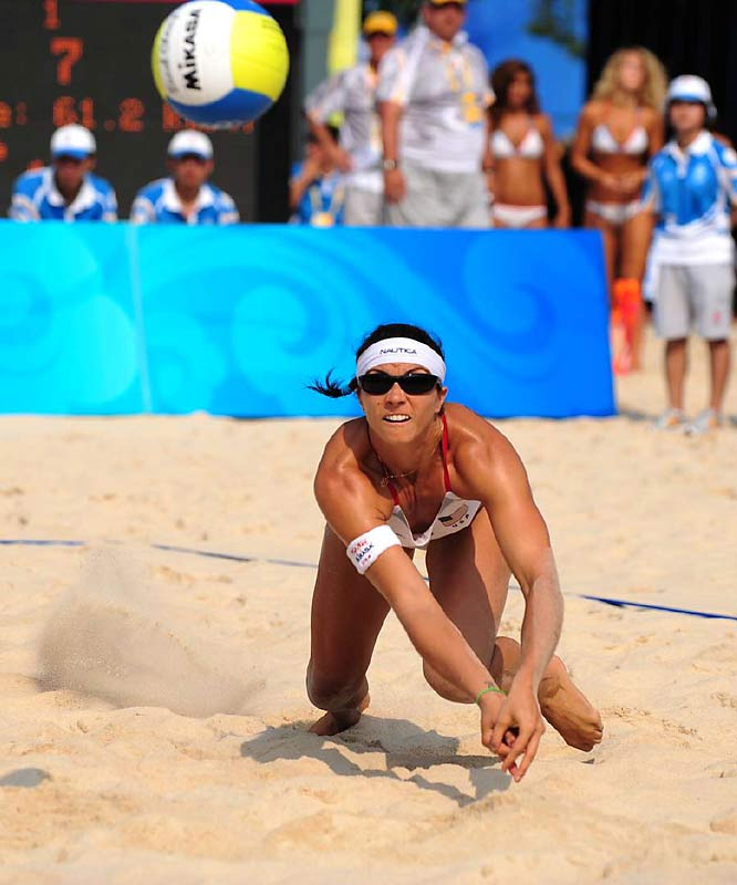 Misty May-Treanor of the U.S. dives for the ball.  She and Walsh won their 107th consecutive match.