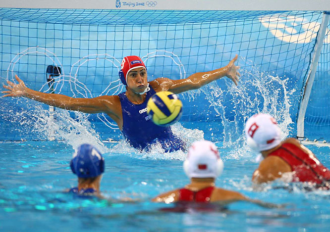 Chiara Brancati of Italy attempts a save against China.  Reigning Olympic champion Italy won the game 10-9 to advance.