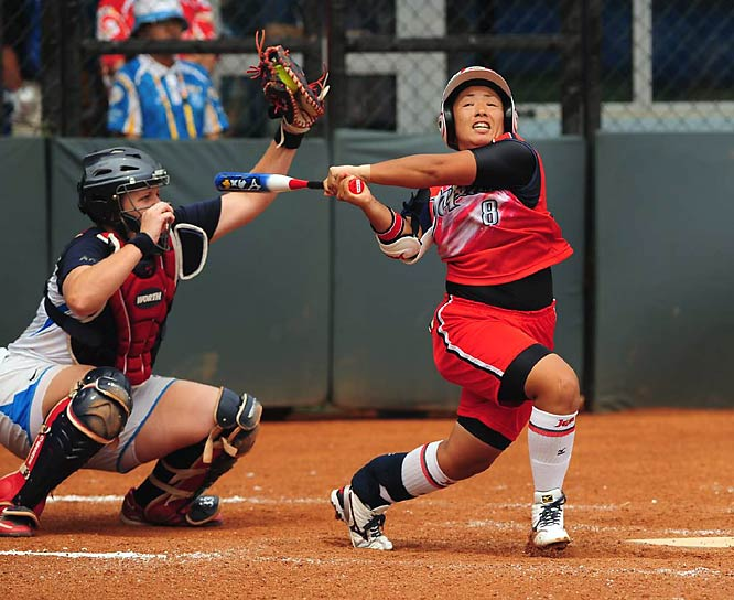 U.S. catcher Stacey Nuveman and her teammates were pushed into extra innings against Megu Hirose and Japan, but scored four runs in the ninth to win 4-1 and advance to the gold medal game.