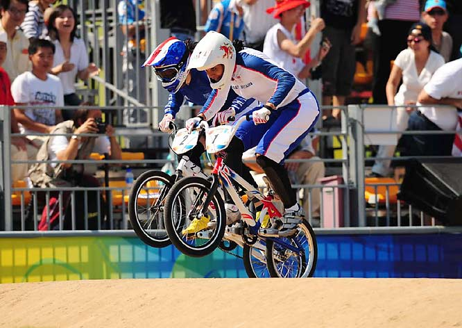 Anne-Carolinie Chausson of France (2) and Great Britain's Shanaze Reade battle it out in the BMX final.
