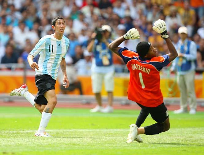 Angel Di Maria of Argentina watches the winning goal sail over goalie NiAmbruse Vanzekin of Nigeria.