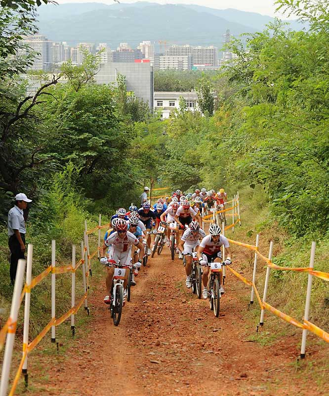 Nino Schurter (6) of Switzerland won the bronze, as France took both gold and silver in the cross country mountain bike final.