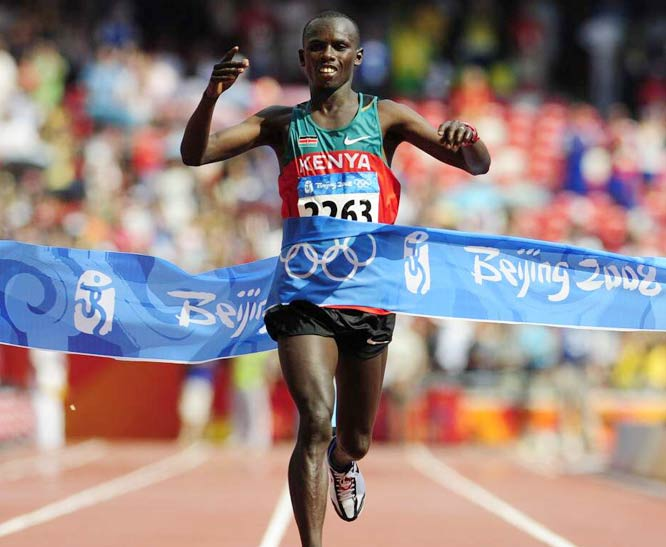 Samuel Kamau Wansiru of Kenya celebrates after setting a new Olympic record in the marathon with a time of two hours, 6.32 minutes.