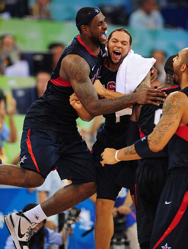 LeBron James and Deron Williams celebrate along with Carlos Boozer.