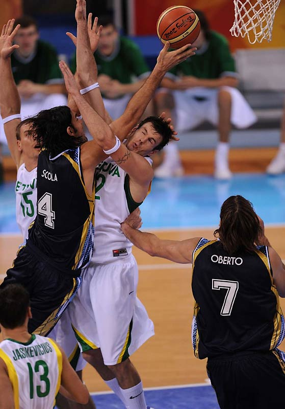 Luis Scola of Argentina drives to the hoop against Ksistof Lavrinovic of Lithuania in the bronze medal game. Argentina won 87-75.