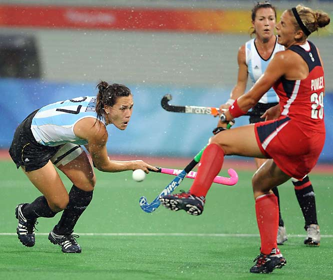 Argentina, shooting for its first Olympic women's hockey gold, was held to a two-all draw by the United States in the rain on Sunday.