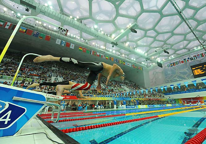 Michael Phelps dominated his first final of the Beijing Olympics, crushing his own world record with a time of 4 minutes, 3.84 seconds in the 400-meter individual medley.
