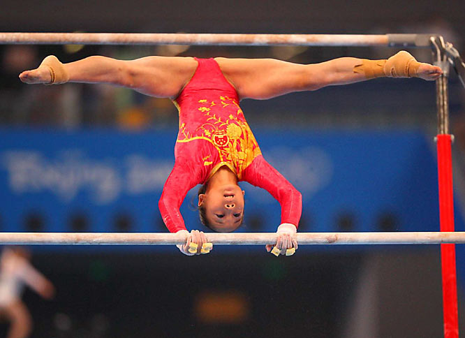 Chinese gymnast Deng Linlin works the parallel bars in the women's qualifying on Day 2.