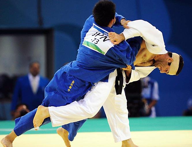 Yusuke Kanamaru of Japan takes on Ali Malomat of Iran in Judo.