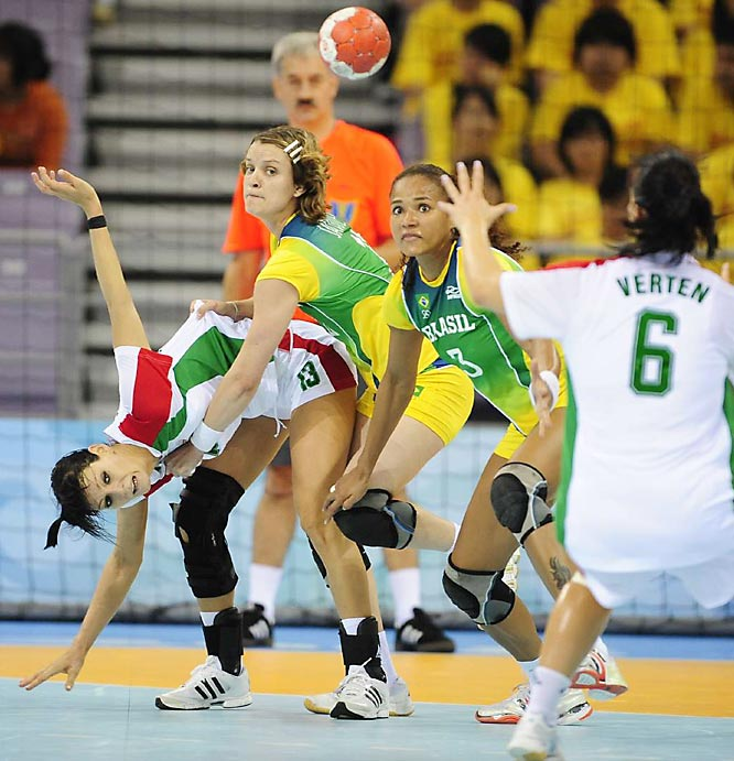Hungary's Anita Gorbicz (13) battles it out with Brazil's Viviane Jacques (11) in the women's team handball on Monday.
