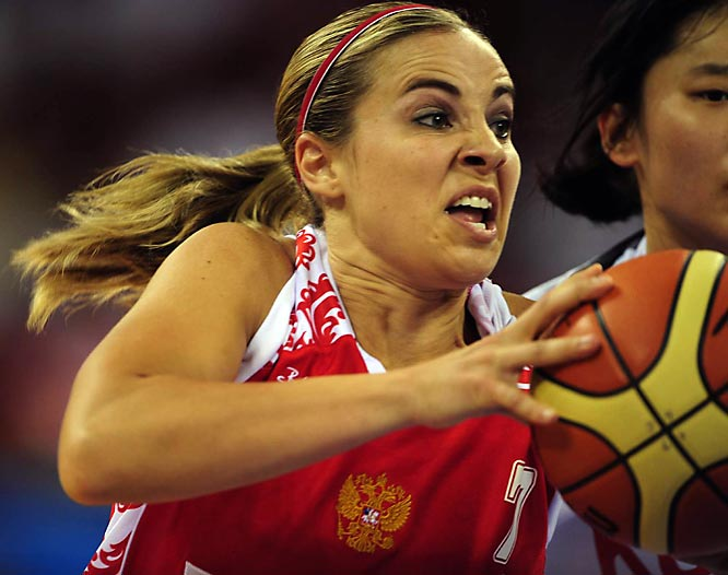 American Becky Hammon, pictured here driving against Korea, is compeing for the Russian team in the Olympics.