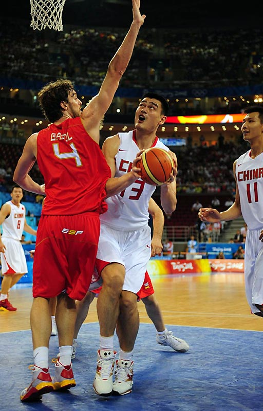 China's Yao Ming looks to get his shot up against Spain's Pau Gasol in a preliminary round game.