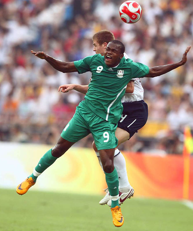 Victor Obinna (9) of Nigeria and Robbie Rogers battle for a ball during a loss that knocked the U.S. out of the soccer competition.