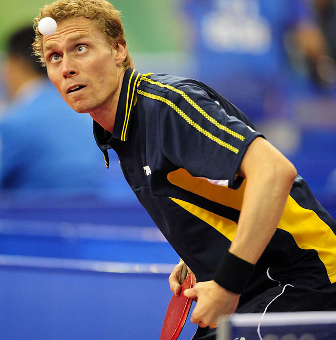 Persson Jorgen of Sweden keeps his eyes on the ball during a table tennis match.