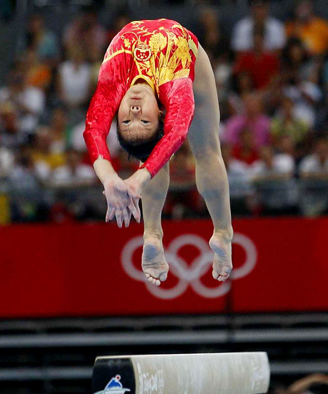 Cheng Fei and China's gymnastics team won the gold, edging the world champion U.S. team into second place.