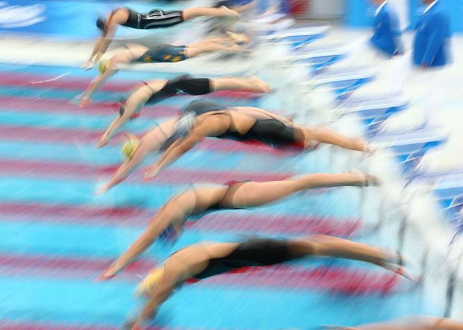Leisel Jones of Australia (yellow cap) starts a semifinal heat in the women's 200m breaststroke.