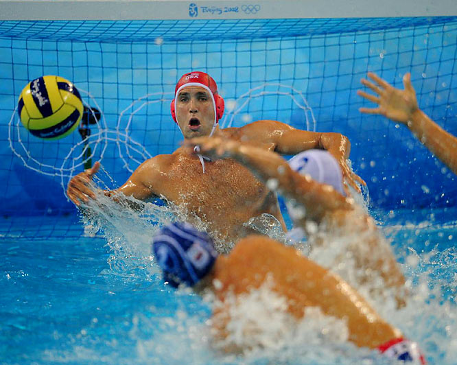 Merrill Moses of the United States scans the pool against Serbia in a men's water polo preliminary match.