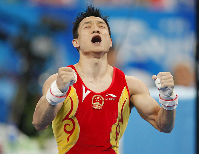 Yang Wei of China celebrates after winning gold in the men's individual all-around competition at Beijing's National Indoor Stadium.