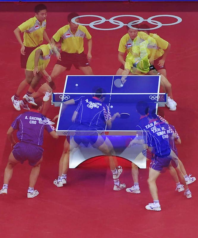 Croatia's Andrej Gacina and Ruiwu Tan (in blue) compete against Singapore's Xiao Li Cai and Zi Yang  in a table tennis preliminary match.