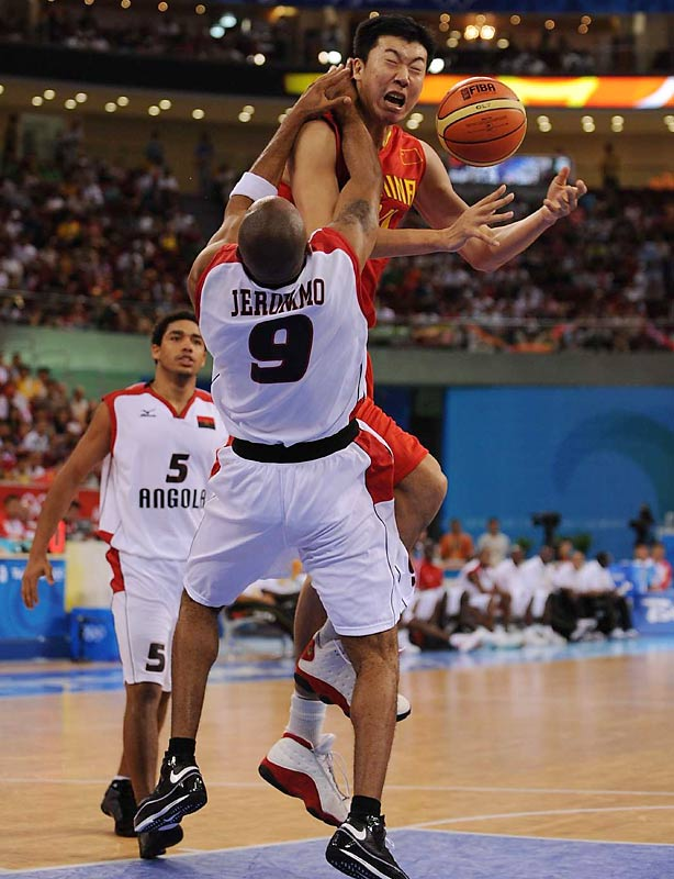 Wang Zhizhi of China runs into resistance from Vladimir Jeronimo of Angola in the host country's 85-68 victory.
