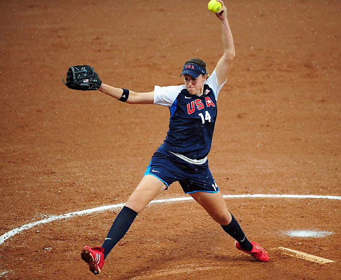 Team USA southpaw hurler Monica Abbott pitches to a Canadian batter in the softball competition.