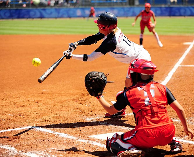 Kelly Kretschman and the U.S. beat  Japan 7-0 in the preliminaries, hitting an Olympic record four home runs.
