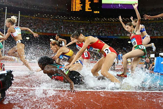 Veronica Nyaruai Wanjiru (2268) of Kenya falls with Zhao Yanni of China close behind during the 3000m steeplechase.