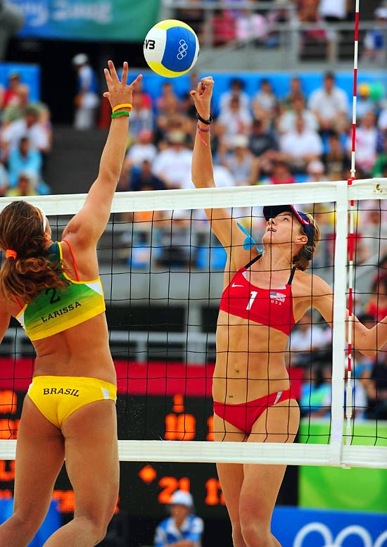 Kerri Walsh goes up against Brazil's Larissa Franca at the net during the Women's Beach Volleyball Quarterfinal.