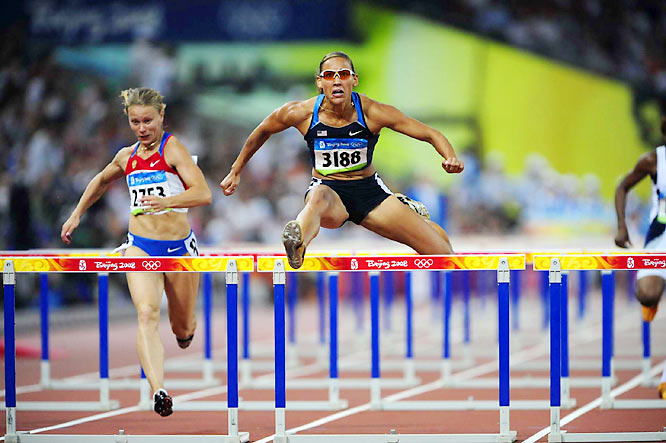 Lolo Jones of the U.S. wins her heat in the first round of the women's 100-meter hurdles to advance to the semifinals.
